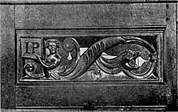 Carving in Attenborough Church shewing intials of John Poutrell.