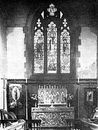 The 1939-1945 War Memorial East Window and Reredos.