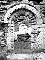 The Norman south doorway of Haughton chapel in the 1920s.
