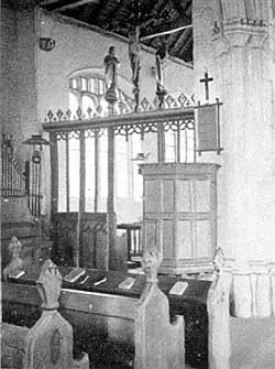 The rood screen and pulpit.