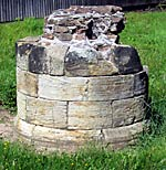 A column base is all that remains above ground of Lenton Priory church.
