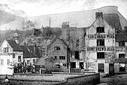 Brew House Yard c.1900. The Gate Hangs Well pub is on the right; the Old Trip to Jerusalem is on the extreme left.