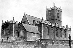 St. Nicholas Church, Nottingham, from the south east, showing sundial destroyed by a storm in 1938 and the tracery in the belfry.