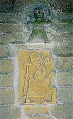 Small Norman figures over the south door of the church (A Nicholson, 2003).