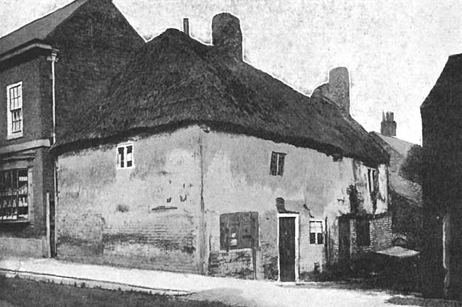 OLD THATCHED HOUSE. Now replaced by Sand Rock House; a similar House was on site of the present Tower House; and two Barns are replaced by Crown House—now forming St. Michael's Place. Two old Thatched Barns occupied site of Darrel House and The Gables, near the Church. Such was West Retford Street in 1848.