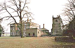 Winkburn Hall and the church of St John of Jerusalam.